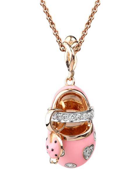 photo of baby shoes brilliant pendant