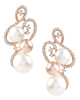 Photo of White and Rose Gold Pearl Earrings