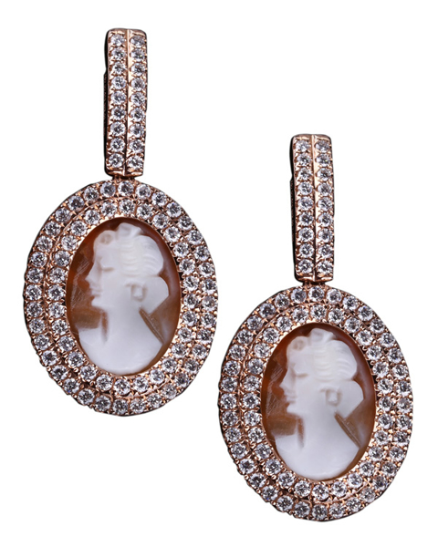 photo of face engraved on coral pendant