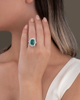 round cut diamond and emerald ring