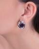 white gold diamond and purple stone earrings